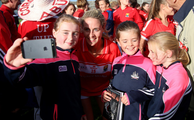 Orla Finn poses in photographs for fans after the game
