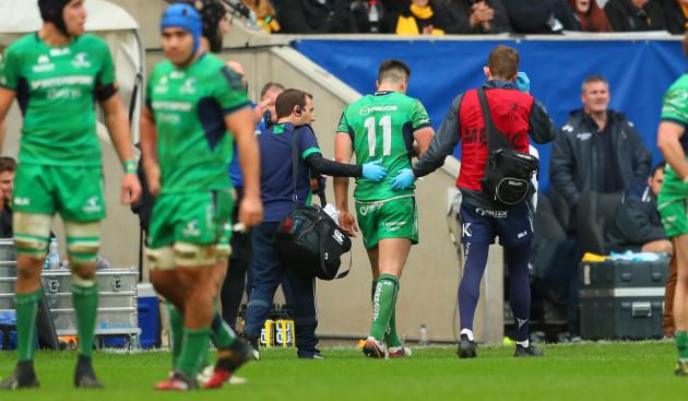 Cian Kelleher leaves the field injured