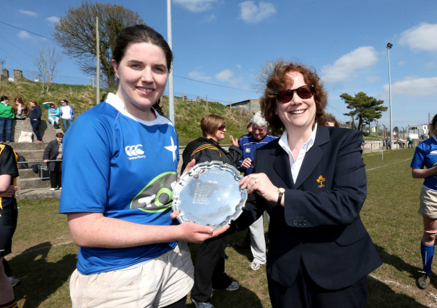 is presented with the Plate by Mary Quinn
