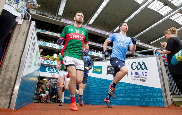 Dublin and Mayo players run out into Croke Park