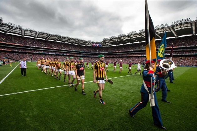 Kilkenny and Galway players walk behind the band