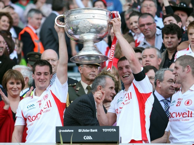 Brian and Tommy McGuigan lift the Sam MaGuire Cup