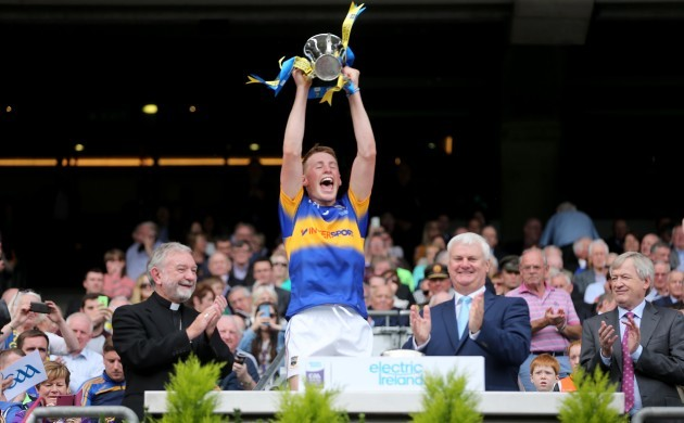 Brian McGrath lifts the cup