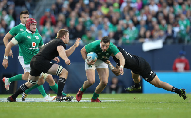 Ireland's Robbie Henshaw is tackled by New Zealand All Blacks's Sam Cane and Aaron Cruden