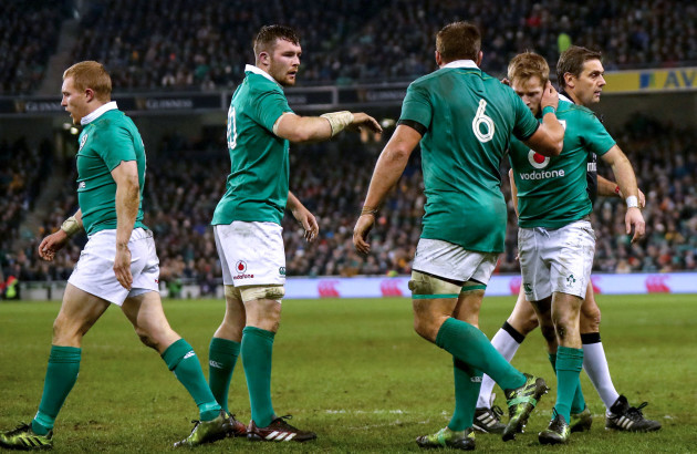 Peter O'Mahony and CJ Stander congratulate Kieran Marmion