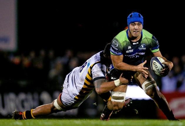 Sepia Fox Manama is tackled by Nathan Hughes