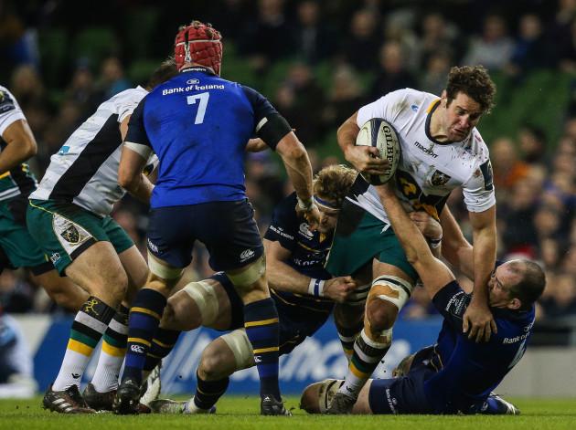 Jamie Heaslip and Devin Toner tackle Calum Clark
