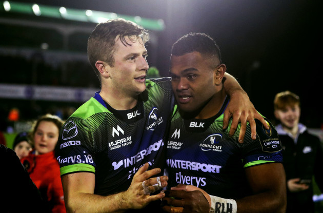 Jack Carty celebrates with try scorer Naulia Dawai after the game