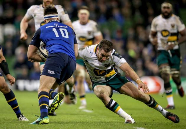 Ross Byrne tackled by JJ Hanrahan