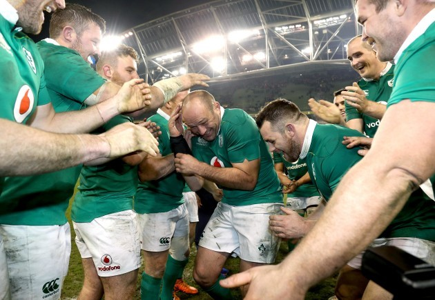 Rory Best celebrates with teammates after the game