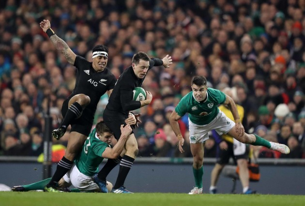 New Zealand All Blacks Ben Smith is tackled by Ireland's Garry Ringrose