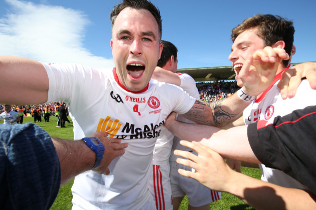 Cathal McCarron celebrates with team mates at the final whistle