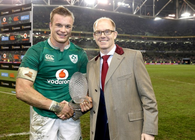 Josh van der Flier presented with the man of the match ward by Mark Sands of Guinness