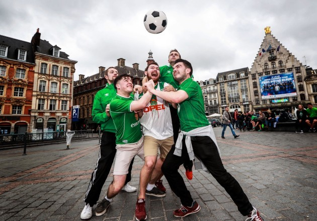 Irish fans play football in the Grand Place