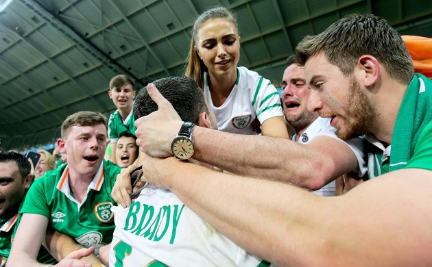 Robbie Brady celebrates with his girlfriend Kerrie Harris and supporters after the game
