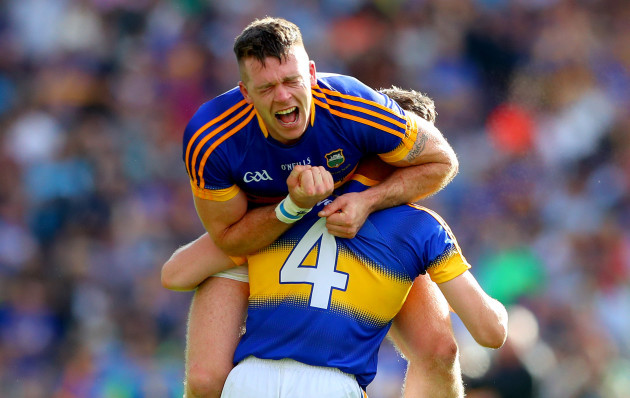 Padraic Maher celebrates after the game with Michael Cahill