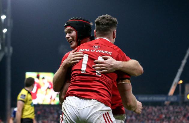 Ronan O'Mahony celebrates scoring a try with Tyler Bleyendaal