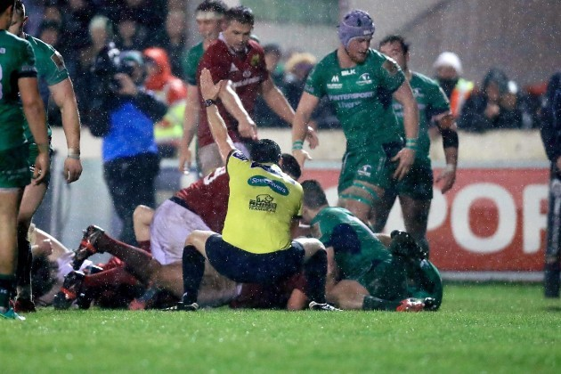Dudley Phillips awards a try to Munster after Rhys Marshall got over the line
