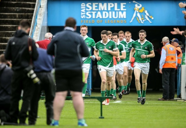 Limerick players arrive out for the start of the match