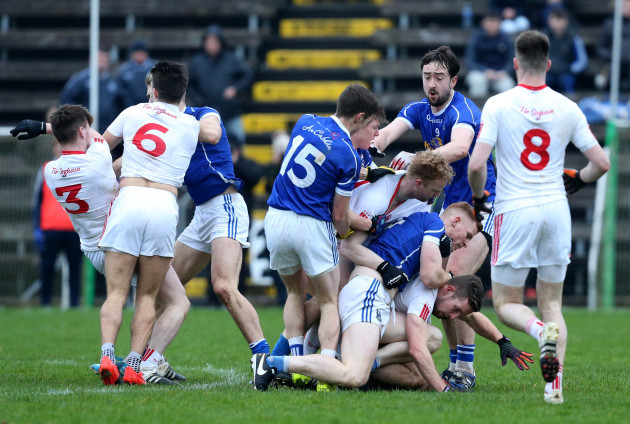 Tyrone and Cavan players clash during the game