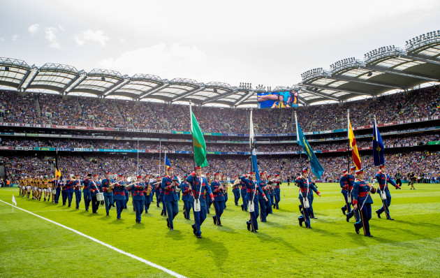 The teams parade before the game