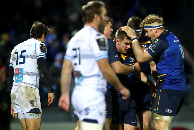 Luke McGrath celebrates his try with Jamie Heaslip