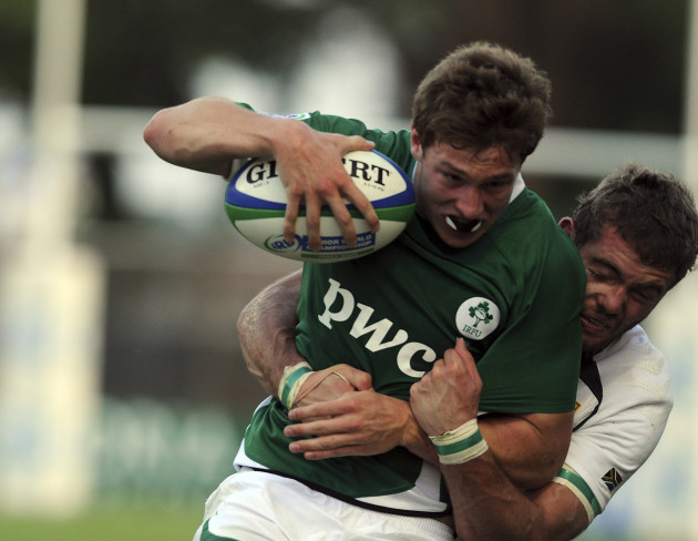 Brendan Macken is tackled by Jaco Taute
