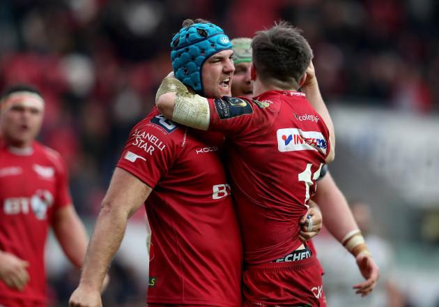 Steff Evans and Tadhg Beirne celebrate at the final whistle
