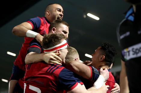 Francis Saili celebrates his try with teammates