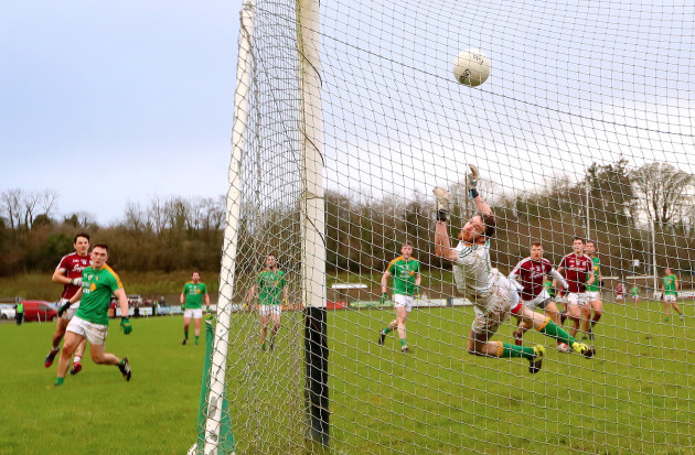 Sean Armstrong (left) scores his sides fifth goal past goalkeeper Phillip Farrelly