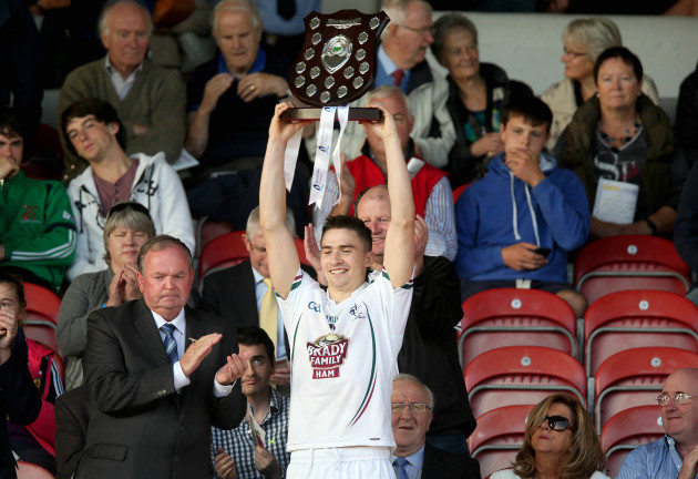 Gerry Keegan lifts the trophy