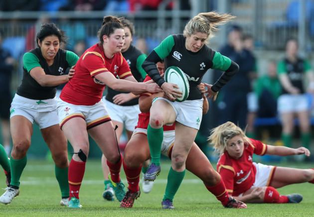 Alison Miller attempts to get through a gap