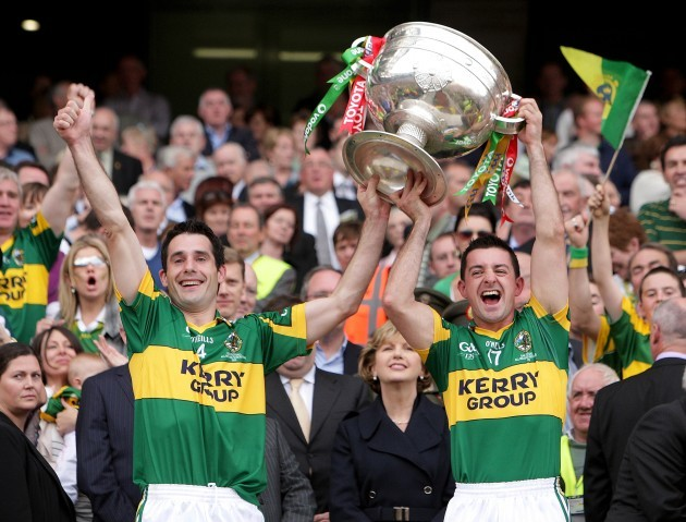 Tom O'Sullivan and Aidan O'Mahony raise the Sam Maguire