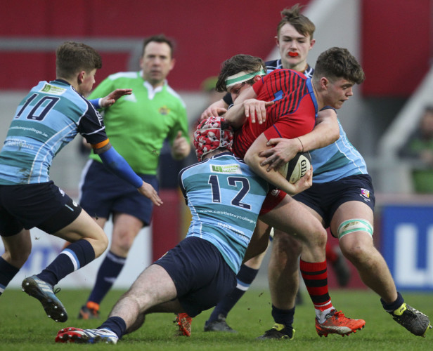 Jake Murphy is tackled by Graham Bourke and Aaron Kennedy