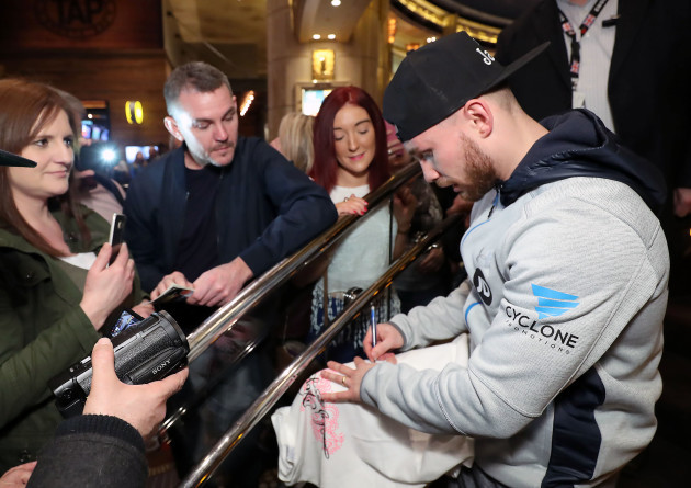 Carl Frampton signs autographs for fans