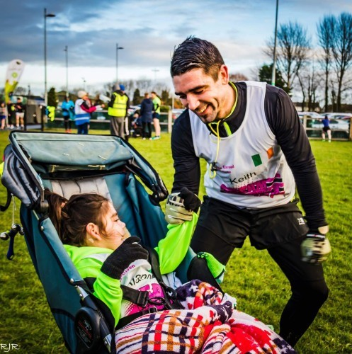 Father vows to run marathon while pushing daughter in wheelchair