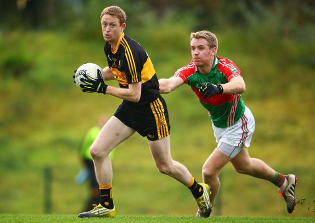 Colm Cooper is tackled by Noel McGrath