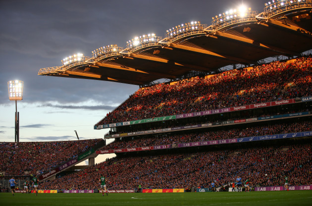 General view of the match as the sun goes down