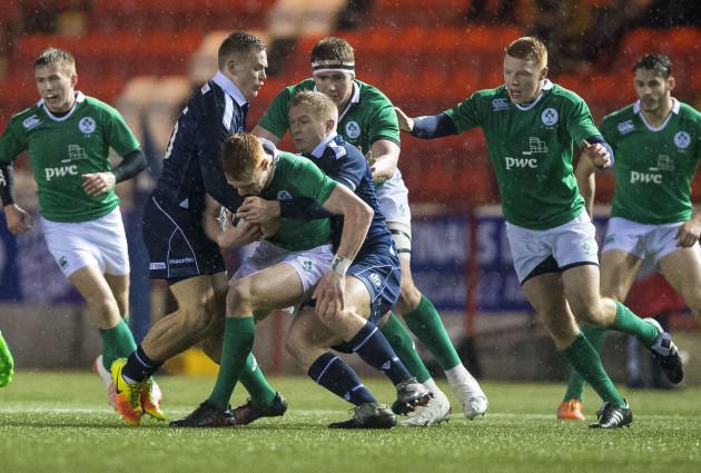 Darcy Graeme and Ross McCann tackle Ciaran Frawley