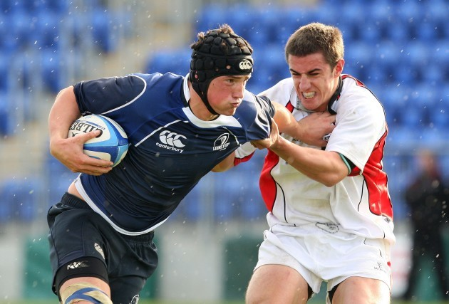 Ben Marshall is tackled by Angus Warwicker