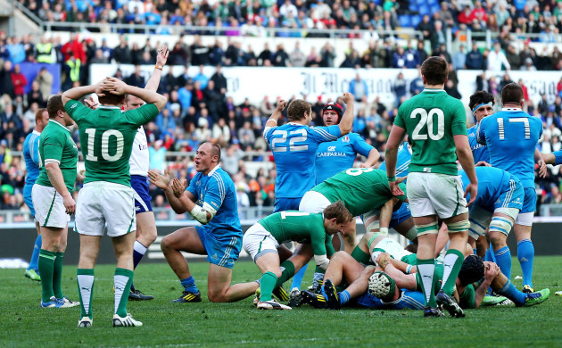 Paddy Jackson looks on dejected as Sergio Parisse celebrates