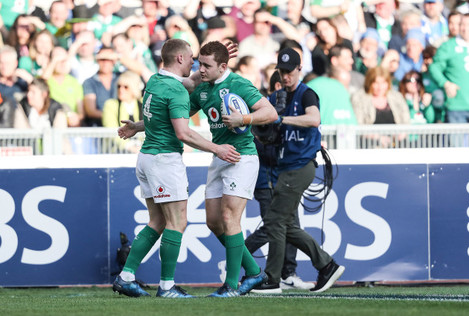 Keith Earls celebrates scoring their third try with Paddy Jackson