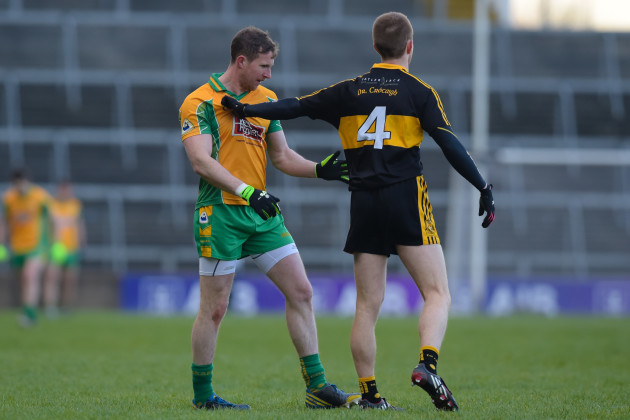 Gary Sice and Fionn Fitzgerald tussle at the throw-in