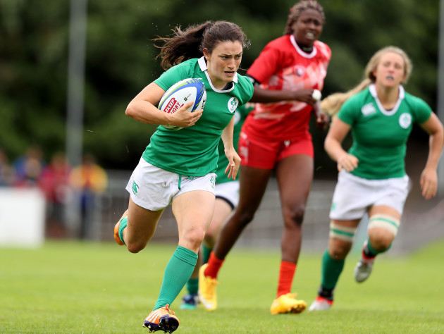 Lucy Mulhall runs in a try