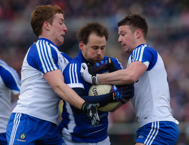 Ryan Wylie and Kieran Duffy tackle Sean Johnston
