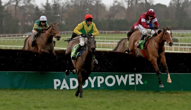 Sizing John and Robbie Power clear the last on the way to winning the race