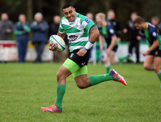 Paulie Tolofua runs in for a try