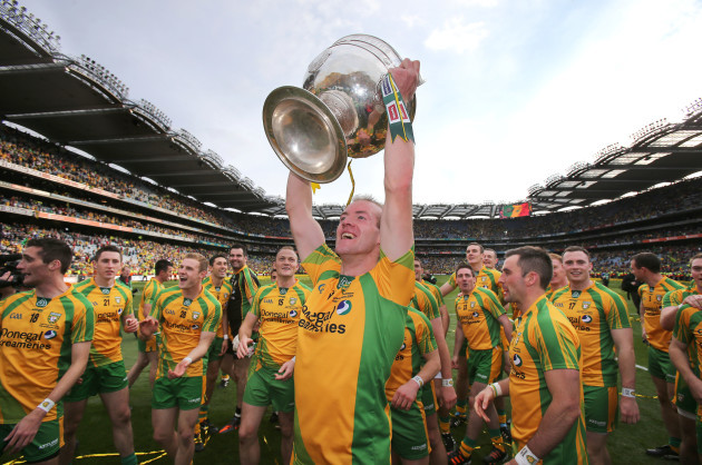 Neil Gallagher lifts the Sam Maguire cup