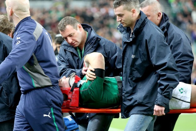 Jonathan Sexton leaves the field in a stretcher