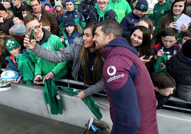 Rob Kearney poses for a photo with a fan